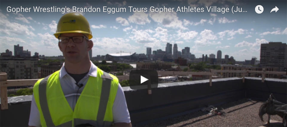 Coach Brandon Eggum tours Athletes Village