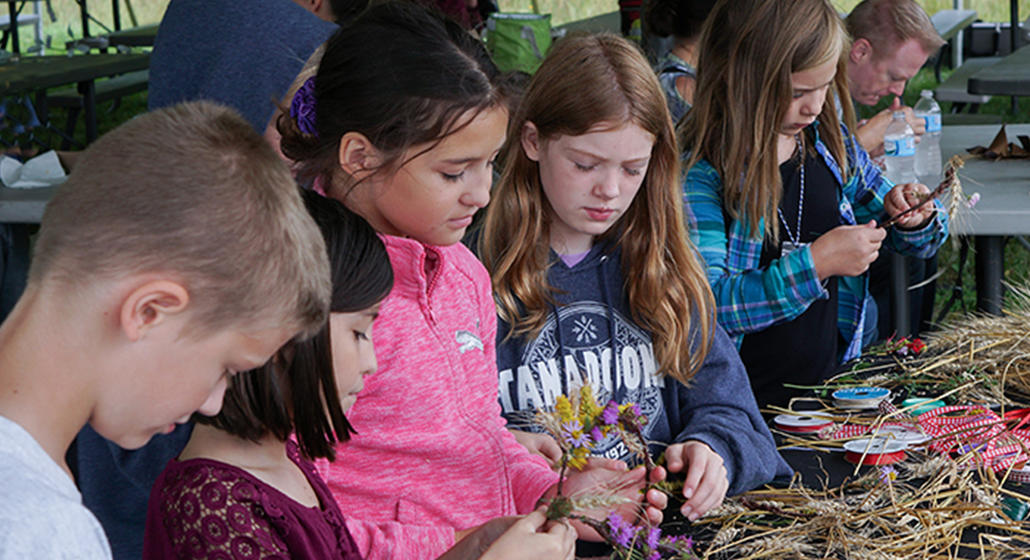 Children play at the Farm at the Arb Field Festival