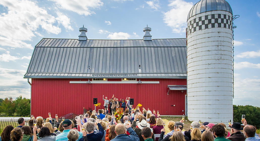 The Arboretum Farm dedication ceremony in front of the historic Red Barn (photo by Jason Boudreau-Landis)